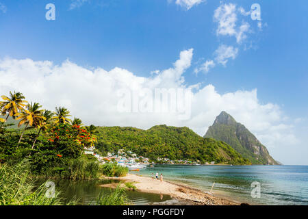 Idyllic white sand tropical beach with view to Piton mountains in Saint Lucia Caribbean - Stock Photo