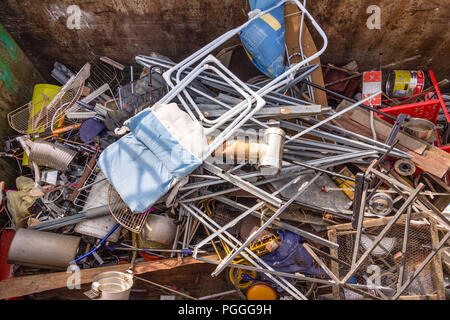 Waste metal products in council recycling depot skip - France. - Stock Photo