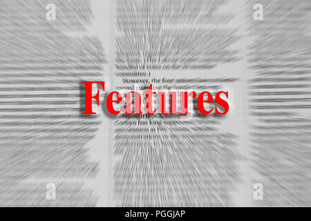 Features written in red with a newspaper article blurred in the background - Stock Photo