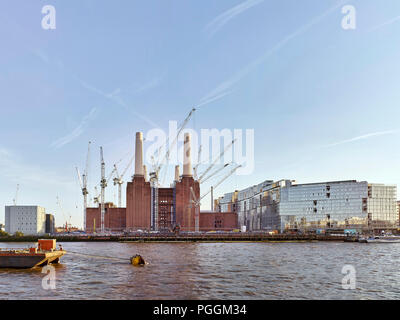 View from north with sunlight. Battersea Power Station, under construction, London, United Kingdom. Architect: Sir Giles Gilbert Scott, 1953. - Stock Photo