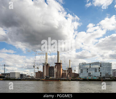 View across river Thames in sunlight with clouds. Battersea Power Station, under construction, London, United Kingdom. Architect: Sir Giles Gilbert Sc - Stock Photo