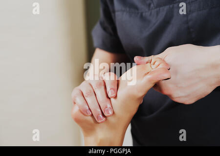 Close-up Of A Physiotherapist Giving Exercise On Man's Foot. - Stock Photo