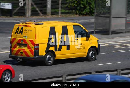 AA breakdown van travelling along a road. - Stock Photo