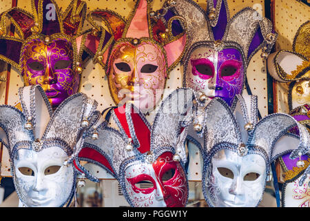 Group of Vintage venetian carnival masks. Venetian masks in store display in Venice. Annual carnival in Venice is among the most famous in Europe. Its - Stock Photo