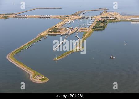 Aerial view Dutch sluices Kornwerderzand between IJsselmeer and Wadden Sea - Stock Photo