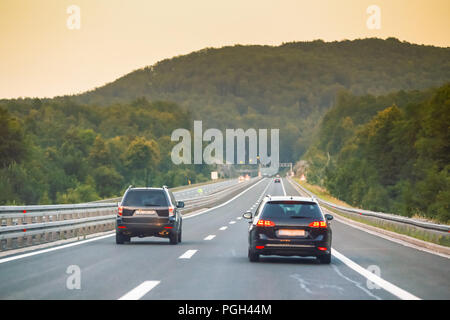 Car driving on the highway from Rijeka to Zagreb with Gorski Kotar forest in the background in Croatia. - Stock Photo