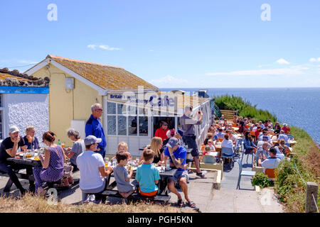 The most southerly point and Polpeor Cove Lizard cornwall England UK The Most Southerly Cafe, Polpeor Cafe - Stock Photo