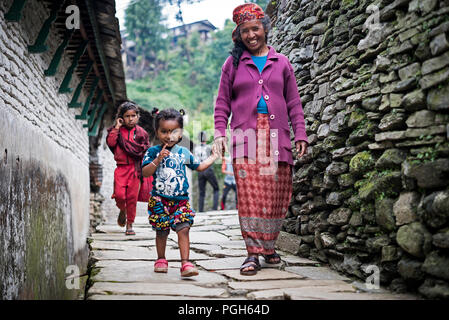 Mother and his daughter hand in hand  in Ghandruk. Annapurna trek. Nepal - Stock Photo