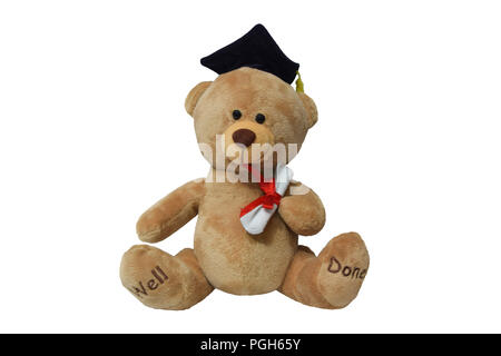 Graduated teddy bear isolated on white - Stock Photo