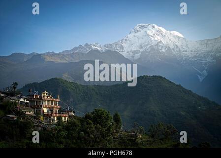 Buddhist sanctuary in Ghandruk and Annapurnas. Annapurna trek. Nepal - Stock Photo