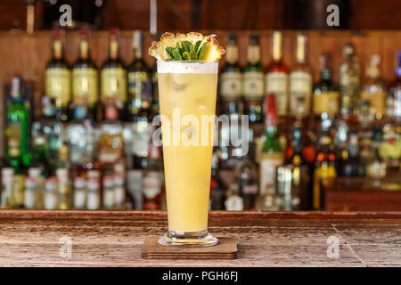 Cocktail shot green mexican with banana liqueur, lemon juice and tequila. Horizontal photo - Stock Photo