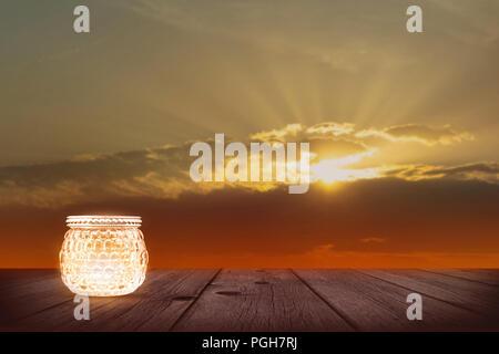 festive light on sunset background - Stock Photo