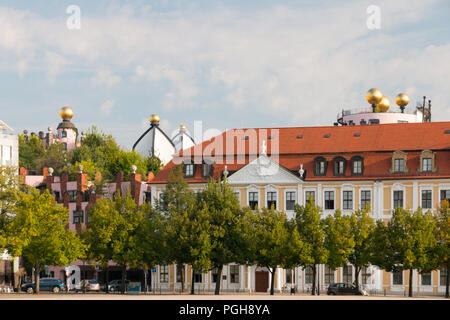 Magdeburg, Germany - August 17, 2018: View of the Magdeburger Domplatz with the Hundertwasserhaus and the state parliament building, Germany. - Stock Photo