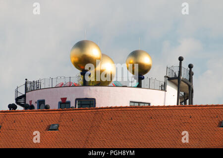 Magdeburg, Germany - August 17, 2018: View of the golden balls of the Hunderwasserhause Grüne Zitadelle in Magdeburg, Germany. - Stock Photo
