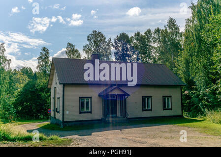 View of the church of the typical Finnish village of Oravi  in summer - Stock Photo