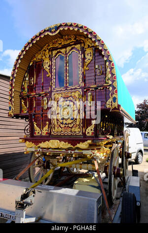 Heavily decorated restored Gypsy caravan. Originally built by Thomas Tong of Kearsley in late19th century - Stock Photo