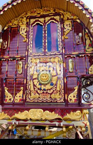 Heavily decorated restored Gypsy caravan. Originally built by Thomas Tong of Kearsley in late19th century - Stock Photo