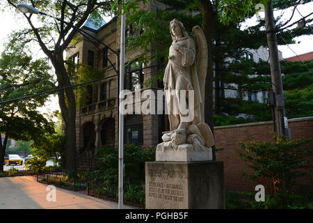 Statue of Archangel Michael outside the entrance to St. Michael's Catholic Church in Chicago's Old Town neighborhood. - Stock Photo