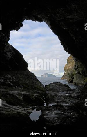 Boreray through the tunnel at Glen Bay on Hirta St Kilda Outer Hebrides - Stock Photo