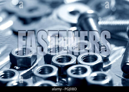 Fasteners written on top of nuts and bolts in blue background - Stock Photo