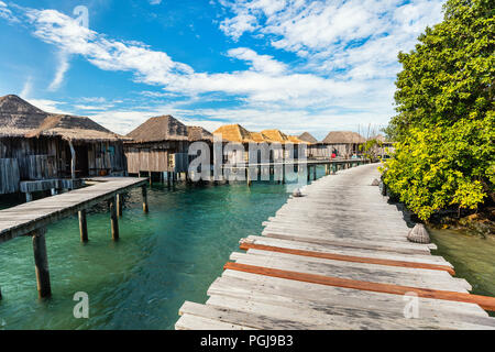 Resort bungalows over tropical water in Cambodia - Stock Photo