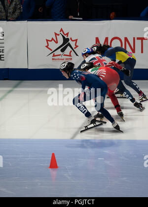 Four female short track speed skaters from the United States, Bulgaria, Great Britain and the Ukraine at the start of a race in Montreal. - Stock Photo