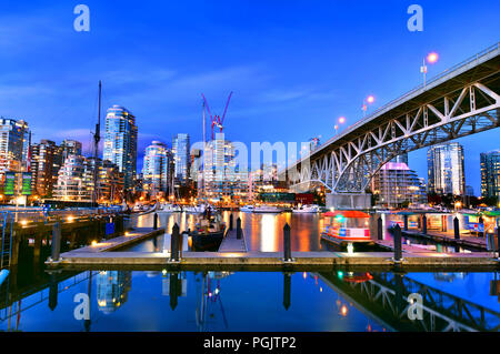 Beautiful view of Vancouver BC next to Granville Bridge along False Creek at twilight time. - Stock Photo