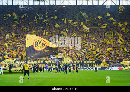 BVB-RB Leipzig Soccer, Dortmund, August 26, 2018 fans, supporters, spectators, club flags,  celebration. south curve, ultras,   BORUSSIA DORTMUND - RB LEIPZIG 4-1  - DFL REGULATIONS PROHIBIT ANY USE OF PHOTOGRAPHS as IMAGE SEQUENCES and/or QUASI-VIDEO -  1.German Football League , Dortmund, August 26, 2018,  Season 2018/2019, matchday 1, BVB,  © Peter Schatz / Alamy Live News - Stock Photo
