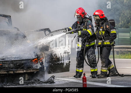 Gdynia, Poland 27th. August 2018  Car fire on the S6 - TriCity ringroad in Gdynia. Firefighters from Polish State Fire Brigade (Straz Pozarna)  are seen while try to controll fire of the Renault Scenic car. Car began to burn violently while driving.  © Vadim Pacajev / Alamy Live News - Stock Photo