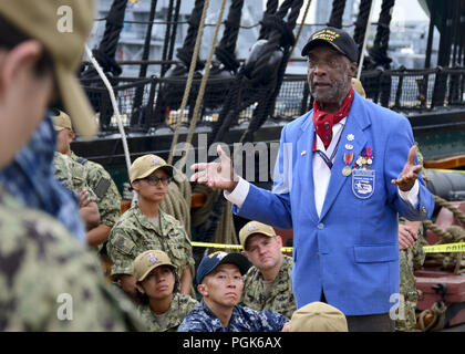 Boston, Mass, USA. 21st Aug, 2018. BOSTON (Aug. 21, 2018) Retired U.S. Air Force Lt. Col. Enoch Woodhouse, an original Tuskegee Airman, takes time to mentor chief petty officer selects as part of USS Constitution's Chief Petty Officer Heritage Weeks. Chief Petty Officer Heritage Week is a week dedicated to mentoring the Navy's newest chiefs through naval history and heritage training aboard America's Ship of State, USS Constitution. (U.S. Navy photo by Mass Communication Specialist 3rd Casey Scoular/Released) 180821-N-SM577-0141 US Navy via globallookpress.com (Credit Image: © Us - Stock Photo