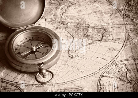 old map of the world and antique brass compass - Stock Photo