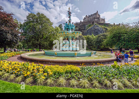 The Ross Fountain in Princes Street Gardens West in Edinburgh Scotland UK with Edinburgh Castle in the background - Stock Photo