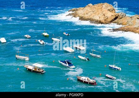 Aerial view of pleasure boats anchored near Shore at  Sa Tuna beach, Costa Brava Spain - Stock Photo