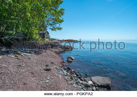 Cabins with sweeping views of Lake Superior, near Grand Marais, Minnesota, USA. - Stock Photo