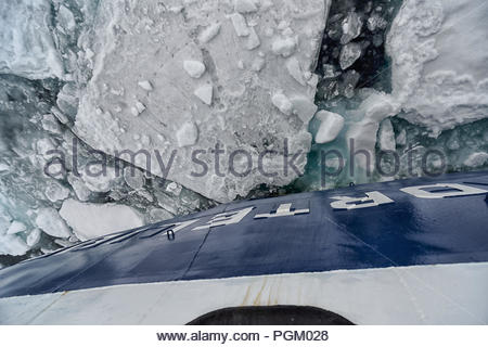 Cruiseship breaking through  sea ice, north of Kvitøya, Arctic Ocean, Svalbard, Norway - Stock Photo