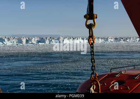Chain and lifeboat of a cruiseship in front of Austfonna, Svalbard, Norway, 2017 - Stock Photo