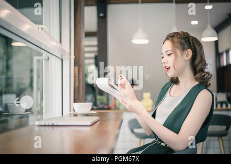 Confident happiness young woman working on laptop or notebook in her office. Beautiful Freelancer Woman working online at her home. Beauty Asian busin - Stock Photo