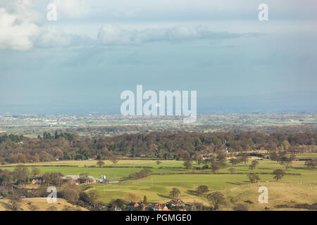 Jodrell Bank radio telescope catches the sun in the distant haze viewed from Beeston Castle - Stock Photo