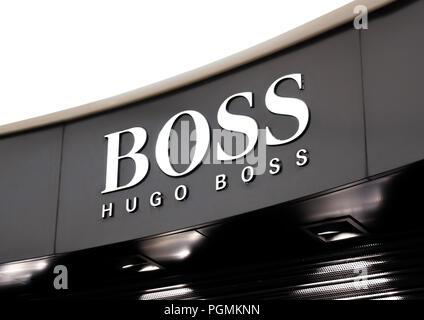 LONDON, UK - AUGUST 31, 2018: Hugo boss logo on display in luxury fashion store. - Stock Photo