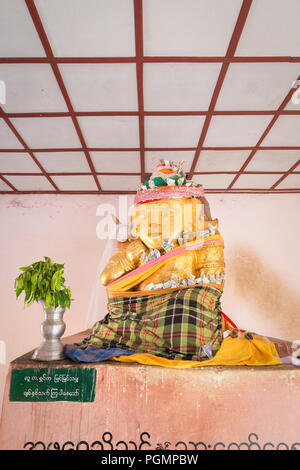 Figure of a Nat spirit, Shwezigon Pagoda, Bagan, Myanmar - Stock Photo