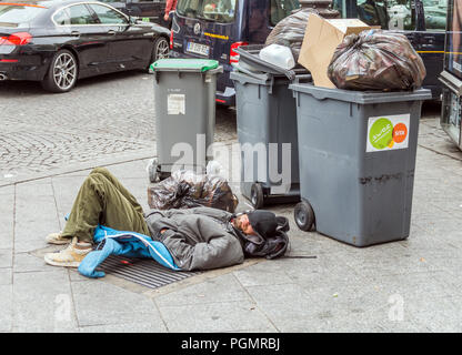 Paris, France 01/06/15 A homeless person lying in the streets of Paris - Stock Photo