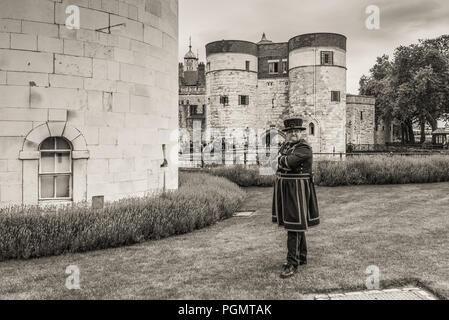 London, UK - May 23, 2017: Yeomen Warders of Tower of London (Beefeaters). Beefeaters are ceremonial guardians of the Tower of London. Monochrome sepi - Stock Photo