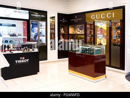 LONDON, UK - AUGUST 31, 2018: Gucci perfume and cosmetic makeup luxury collection in boutique store. Elegant shop. - Stock Photo