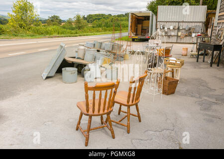 Secondhand goods for sale outside a rural shop, UK - Stock Photo
