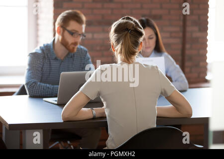 Female work candidate applying for job in office - Stock Photo