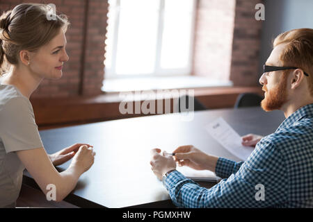 Recruiter considering female applicant candidature during interv - Stock Photo