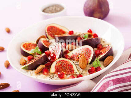 Delicious and healthy oatmeal with figs, almond and chia seeds. Healthy breakfast. Fitness food. Proper nutrition. - Stock Photo