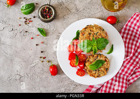 Spicy vegan burgers with rice, chickpeas and herbs. Salad tomato and basil. Vegetarian food. Top view. Flat lay - Stock Photo