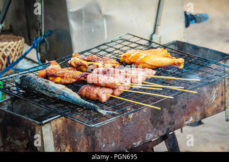 Grilled Beach Food For Sale Including Fishes Chicken Sausages At