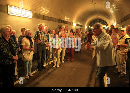 Guided sightseeing-Tour in the Old Elbe Tunnel, St. Pauliu, Hamburg harbor, Germany, Europe - Stock Photo